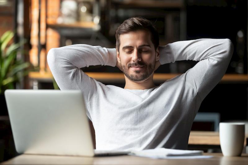 executive man meditating at desk